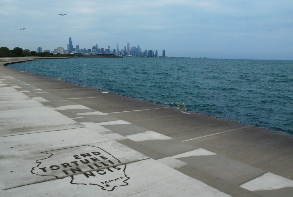 Tamms Year Ten mud stencil on the lakefront at 37th Street East. Photo by Paul Kjelland.