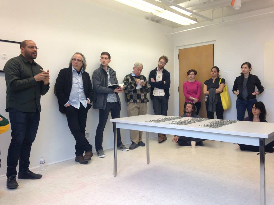 Sociologist Gary Fines (centered, with notepad) at a graduate critique in Northwestern University's Art Theory and Practice program