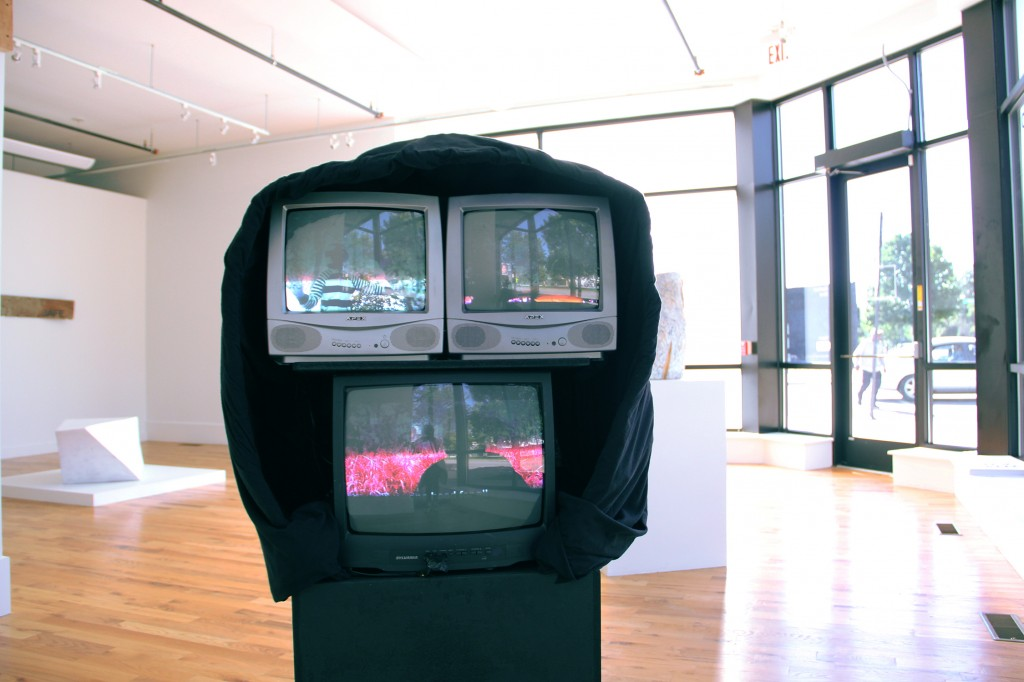 """Amir George. """"""""The Hood We Live In,"""" 3-channel video installation"""