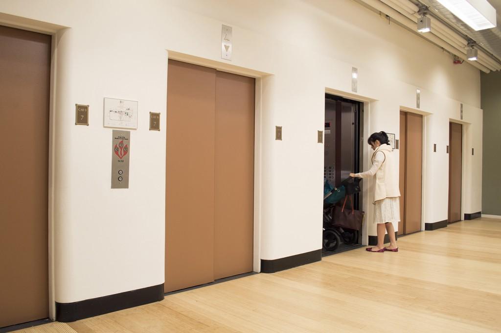 "Kelly Lloyd. ""I painted the elevator doors the color of my skin. C1, 21,1—E0,13,0—KX0,22,1—V0,37,0,"" 2014 acrylic on elevator doors"
