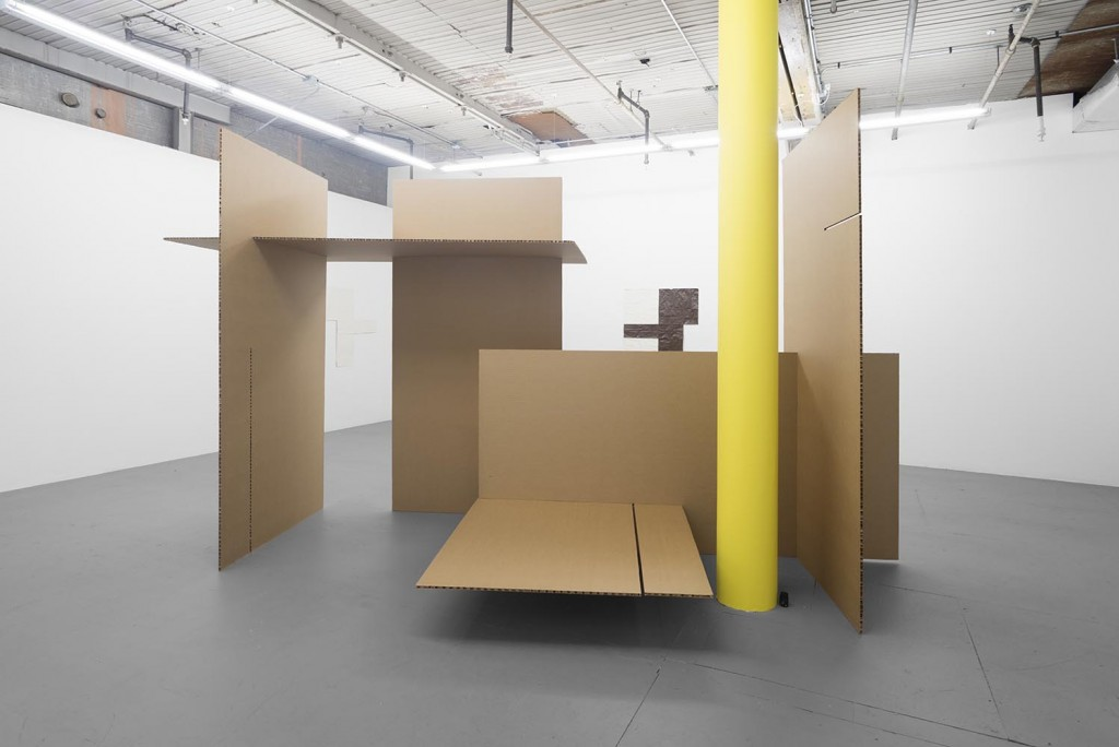 Installation view of Marcus Geiger sculpture and column covering