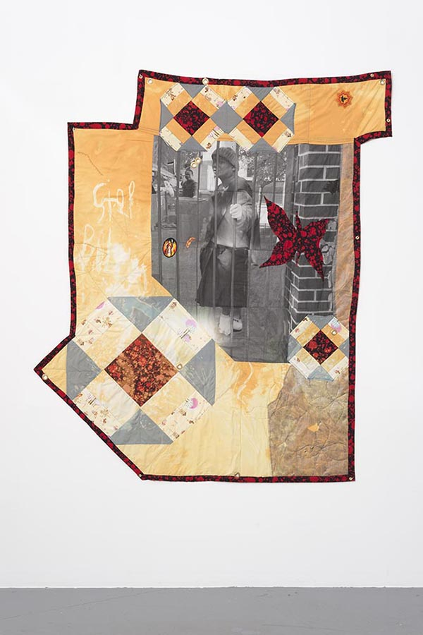 "Erin Jane Nelson. ""Monk Behind Bars,"" 2015 Inkjet on cotton, cotton, embroidered patches, wool batting, silk ribbon, garden lining fabric, grommets"