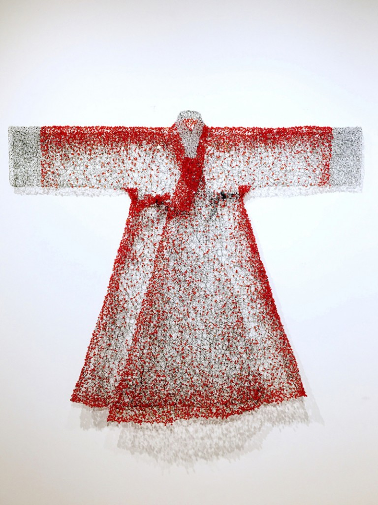 """Keysook Geum. """"Red Jangot,"""" 2015. Black wire with red beads, 65 x 53 x 10 inches."""