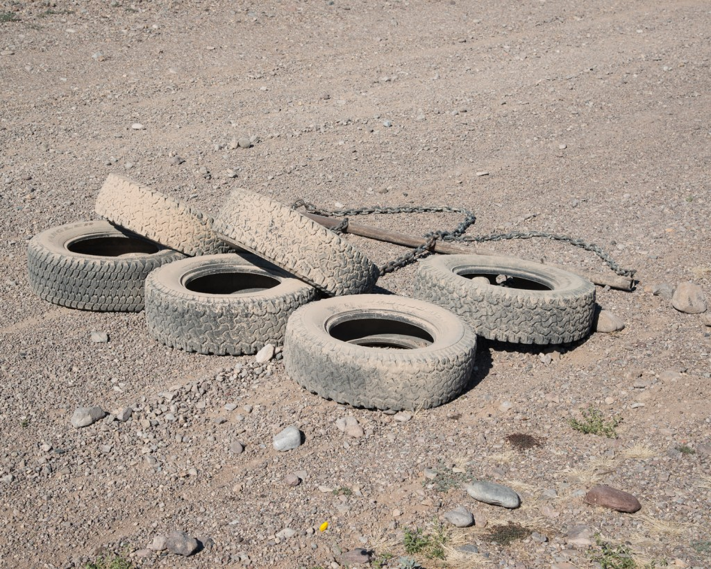 "Jason Reed. ""Drag Tires (for Cutting Sign), Presidio, Texas,"" 2013."