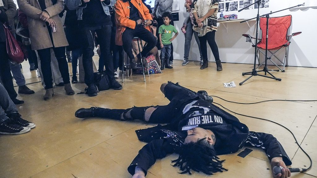 "Vic Mensa performing at the opening night of ""our duty to fight"" at Gallery 400. /Photo: Ji Yang"