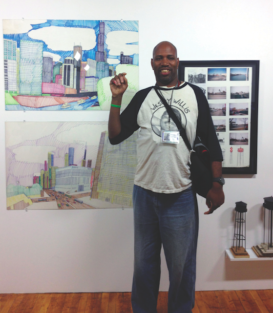 Ricky Willis with his sculptures, and drawings by Wesley Willis
