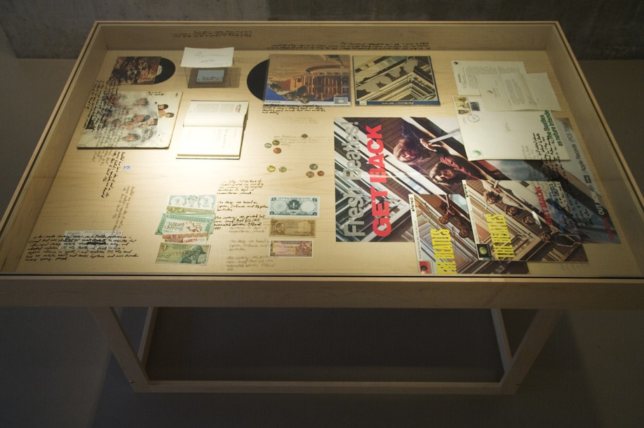 """""""Study for The Breakup – Fantasy Objects,"""" 2012, Get Back fantasy album and ephemera, 1970; Joe Orton, Up Against It, book; Live in Saratha fantasy album, 1969; Beatles signature in the hand of Paul McCartney, 1965; Yoko Ono, Now or Never LP, 1972; Yesterday and Today LP, butcher cover, 1966; Muammar Gaddafi stamp, 1986; fantasy concert ticket, 1965; Israeli currency for the Occupied Territories, never printed in Israel, 1967; Coins, never issued in California, 2010; Currency from Jordan, Syria and Egypt, 1967."""