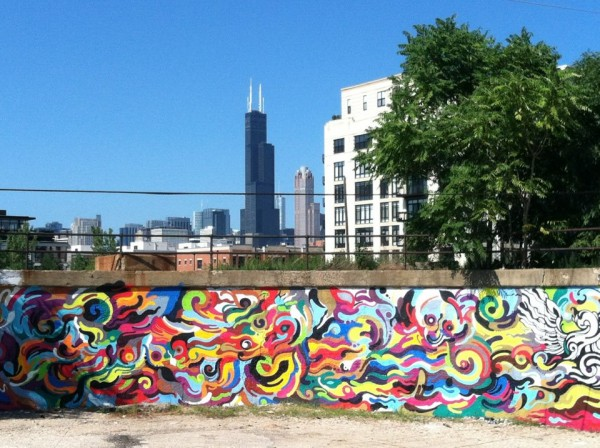 A 2012 mural by Reyes at 16th and Morgan Street co-produced by Art in Public Places and Pawn Works