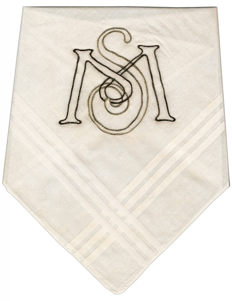 """Miller & Shellabarger. """"S & M,"""" beard hair couched on 100% cotton handkerchief, 2013 10.5"""" x 8.5"""" folded, 16"""" x 16"""" open"""