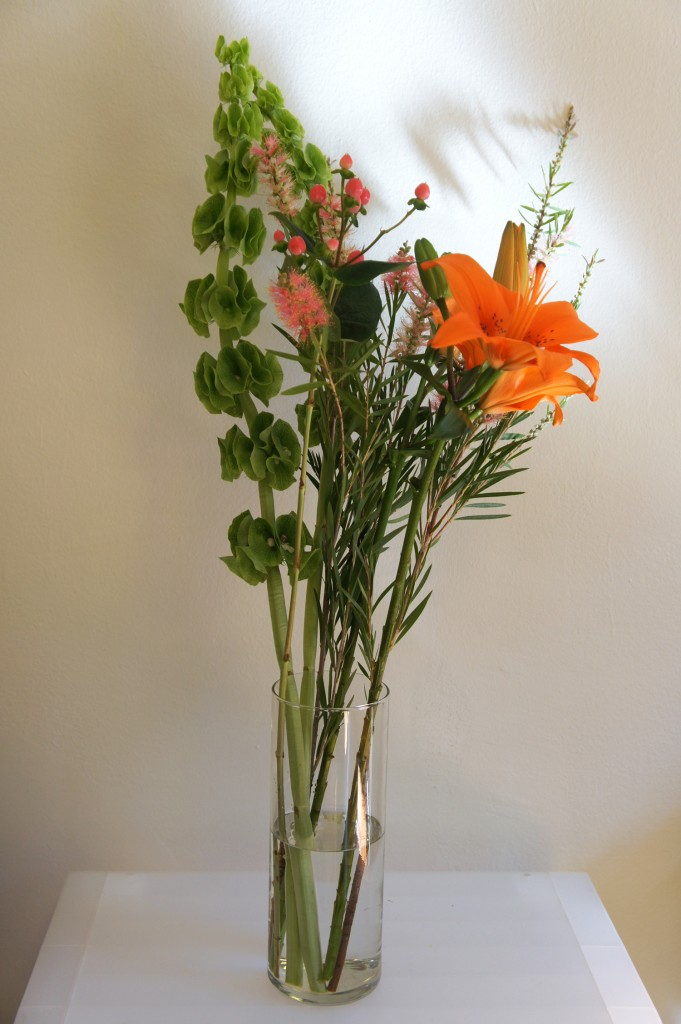 A special collaborative flower arrangement CAD staff made for Newcity. The flowers are: Hyperacum, Bottlebrush Protea, Lily, and Bells of Ireland.