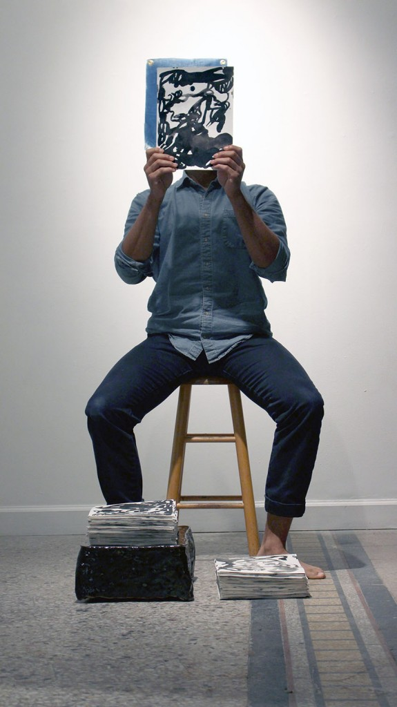 "Daniel Giles in the performance component of ""500 faces for the wanderer"" at the exhibition's opening reception."