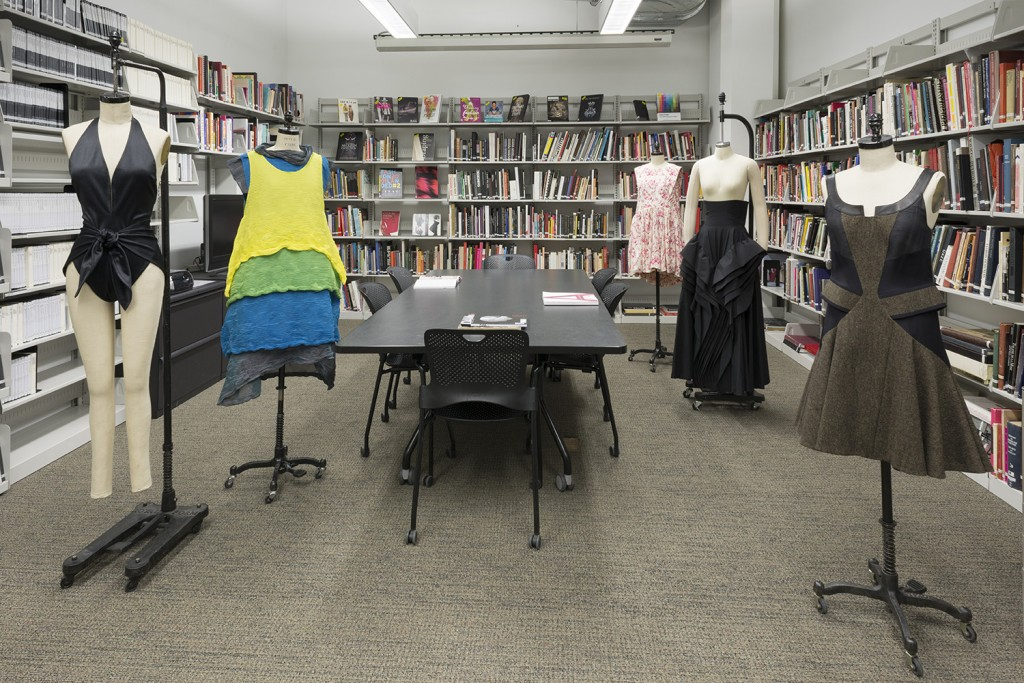 Several garments on display in the Fashion Resource Center's reading room
