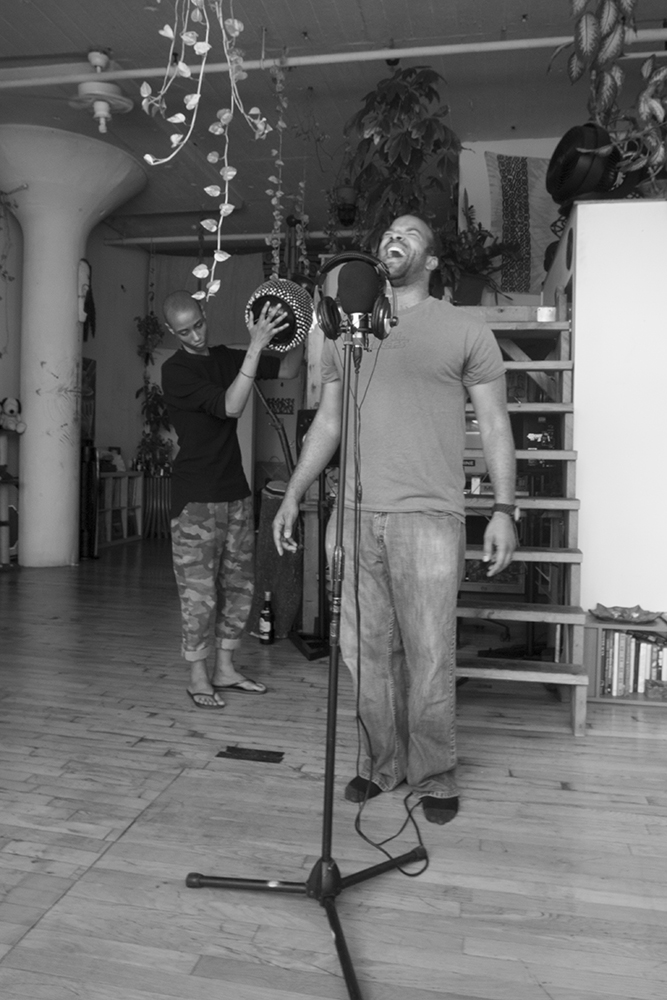 """Val Jeanty and Douglas Kearney rehearsing """"Freedom of Shadow: A Tribute to Terry Adkins"""" at Jeanty's studio in Brooklyn. Photo by zkonqü."""