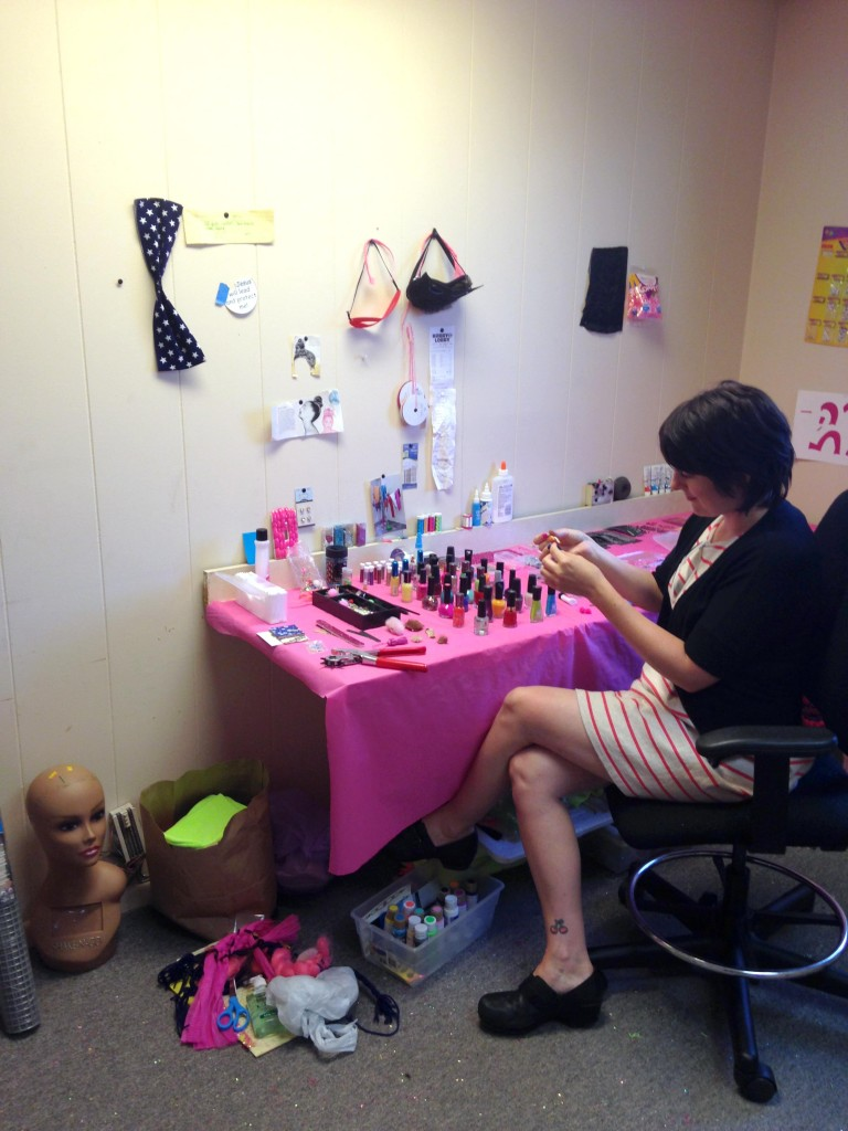Sarah Beth Woods at work on nail art related projects