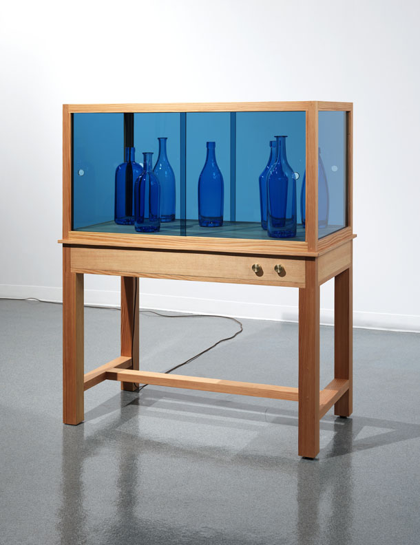"""Josiah McElheny. """"End of a Love Affair,"""" 2014, handblown and polished glass, douglas fir, speakers, amplifier, industrial audio player, electric wiring, cut and polished blue sheet glass, brass control knobs, felt, hardware, 55 x 43 x 23 inches"""