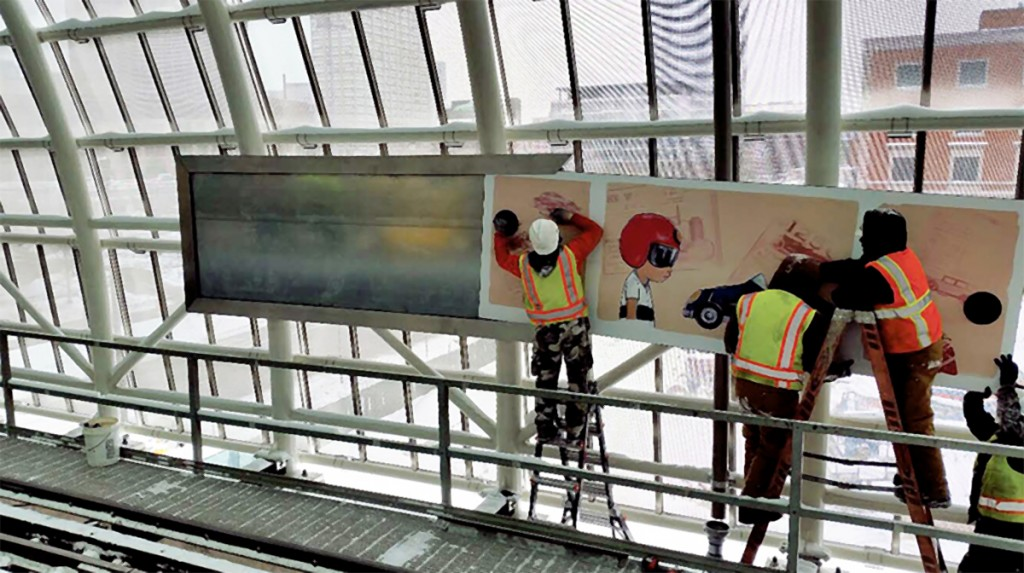Hebru Brantley's art panel being installed at CTA Green Line McCormick Place station