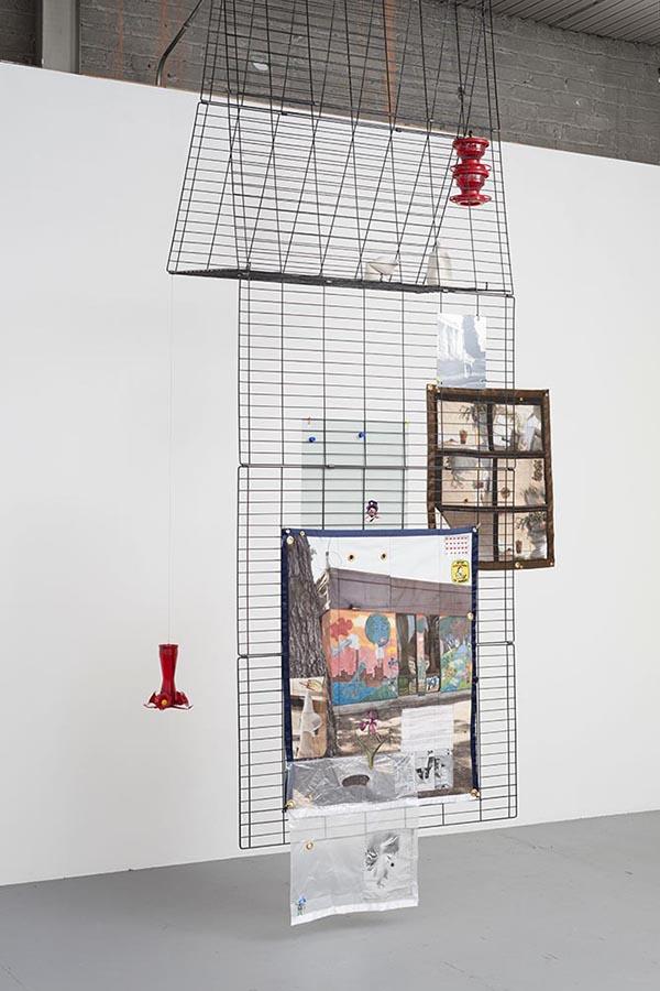 "Erin Jane Nelson. ""Premium 8 Panel Exercise Pen,"" 2015 dog playpen, hummingbird feeders, porcelain bottles, quilt, aluminum prints, carabineers"