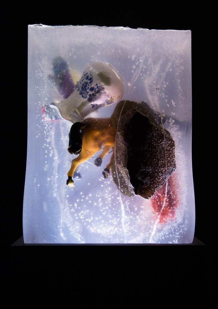 "Jessica Hyatt. ""Family Portrait Negative,"" 2015 objects cast in clear ballistic gelatin"
