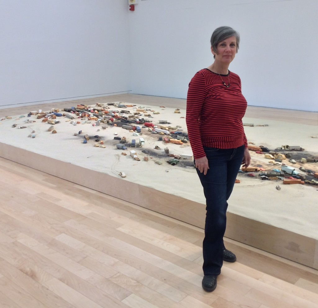 """Alison Ruttan in her installation """"A Line in the Sand,"""" at the Chicago Cultural Center"""