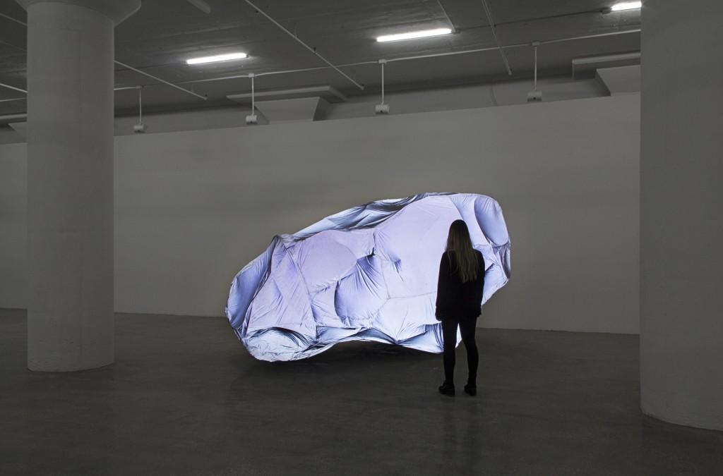 "Chris Meerdo and May Wilson. ""Cataphote,"" 2014 welded steel, retroreflective fabric, zippers, vacuum, 16' x 18' x 9'"