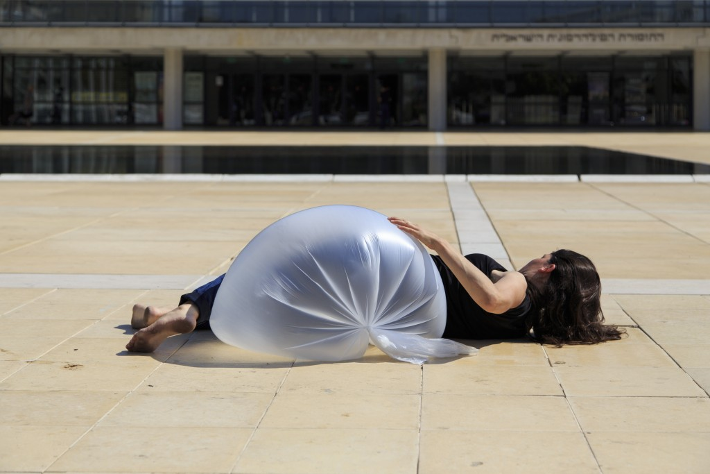 "Michal Samama. ""Lament of Plastic,"" performance. Photo by Guy Kremnitzer."