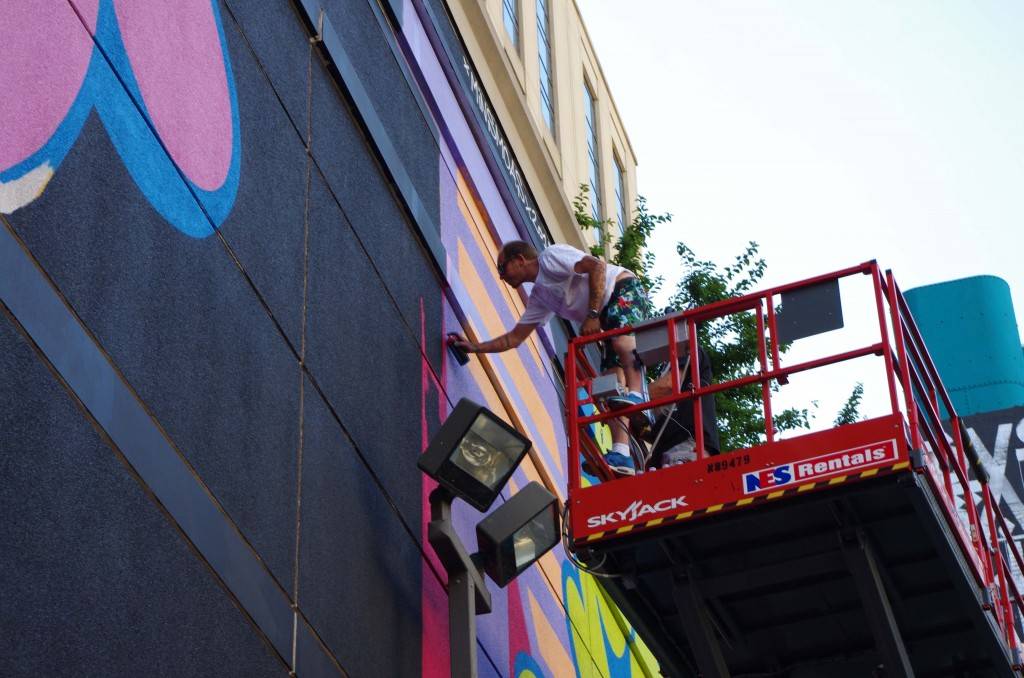 Ben Eine working on his mural at South Wabash.