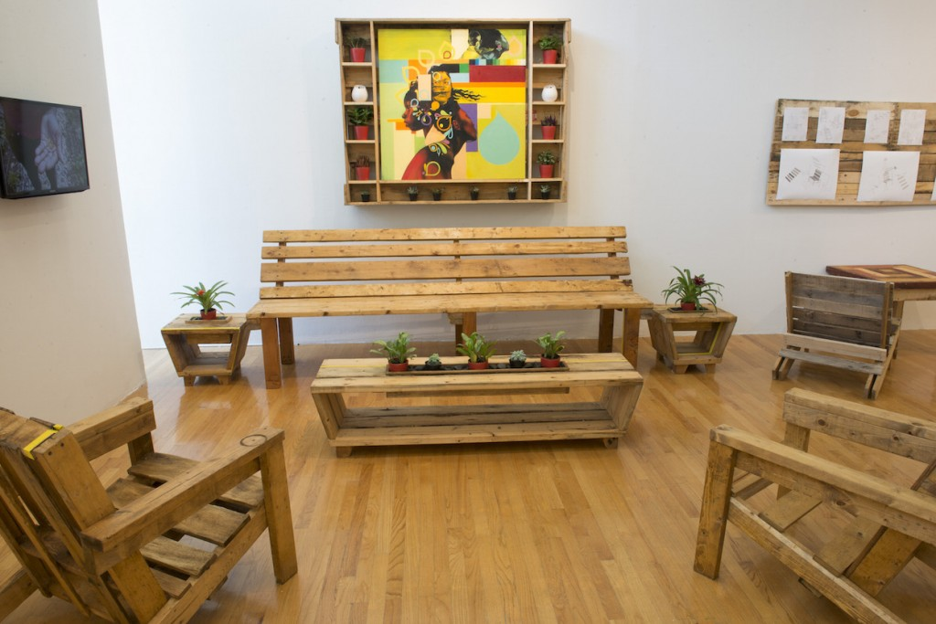 """Emmanuel Pratt in collaboration with Sweet Water Foundation. """"Ecology of Absence?"""" Furniture, shelving and American flag made from reclaimed wooden pallets. /Photo: Rob Karlic."""