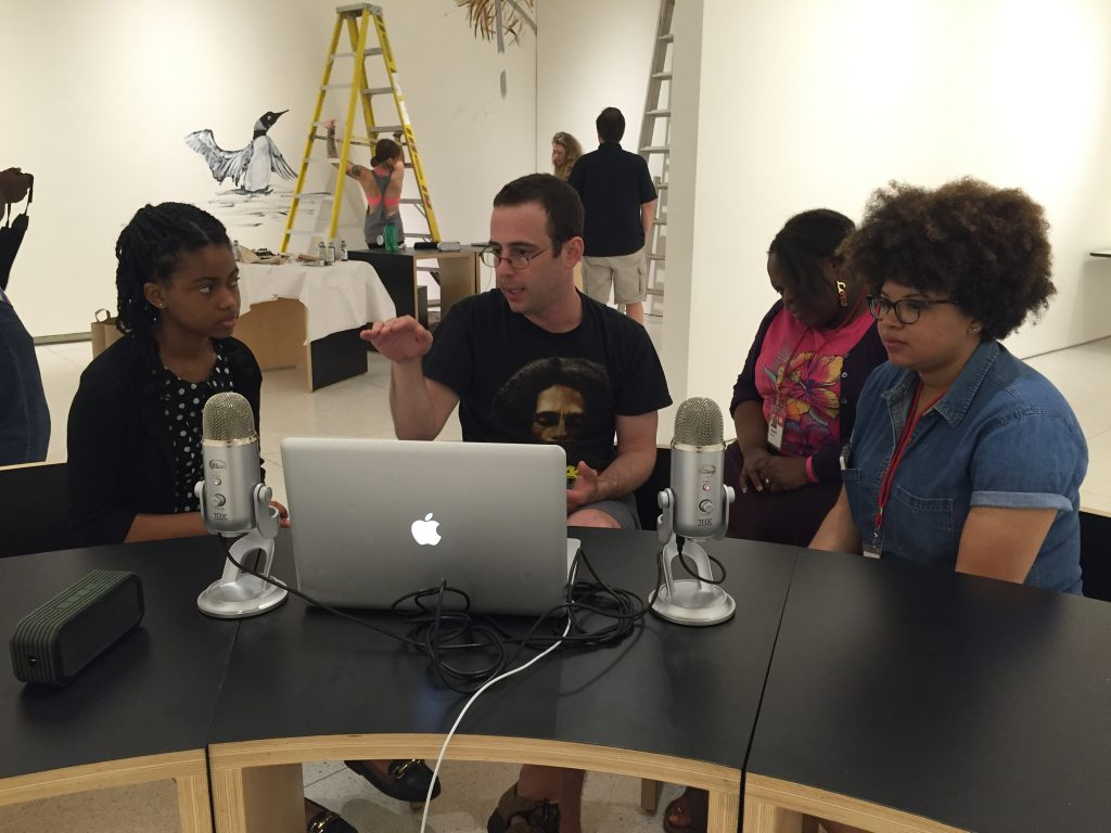 David Ladon (center) leading a workshop on conducting radio interviews with museum docents and an educational fellow for the Stockyard Institute.